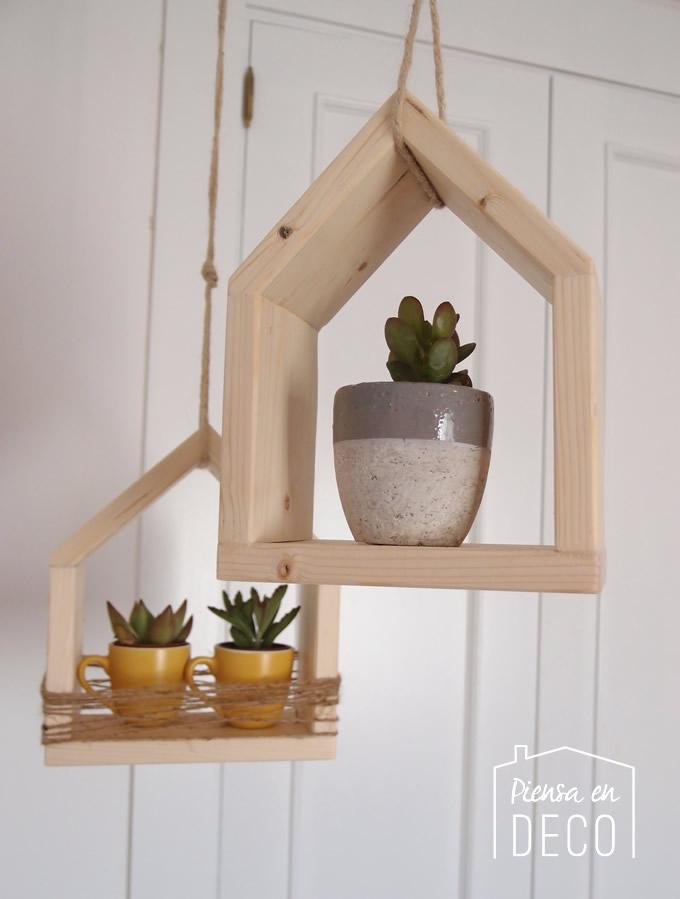 estante colgante con forma de casa para macetas